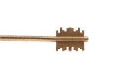 古铜色钢钥匙头。 库存照片