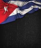 古巴在一个难看的东西黑色黑板的旗子葡萄酒有Te的空间的 图库摄影
