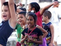 古巴普拉多大道的小学生的面孔 库存图片