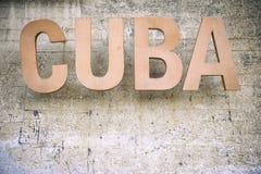 古巴标志被风化的石背景 免版税库存照片