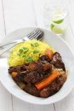 古巴牛尾炖煮的食物用黄色米 库存图片