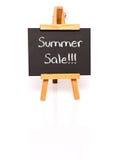 另外的背景是蓝色蝴蝶装生动被更改的标志格式销售额天空夏天的星期日于罐中 有文本和画架的黑板 库存照片