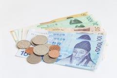 另外价值韩国货币票据和硬币,保存您的金钱概念 库存照片