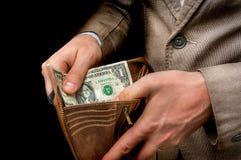 只供以人员拿着有里面一美元的皮革钱包 免版税库存图片