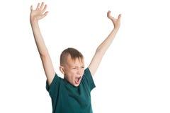 叫喊的男孩用被举的手 库存照片