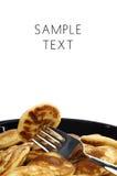 叫的荷兰语微型薄煎饼poffertjes 免版税库存照片