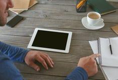 召开会议的商人在家庭办公室 免版税库存照片