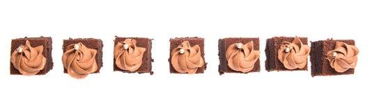 叮咬大小的巧克力蛋糕VI 库存图片