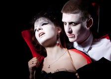 叮咬夫妇吸血鬼 图库摄影
