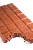 叮咬巧克力 免版税库存照片