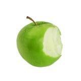 叮咬绿色苹果 免版税库存照片