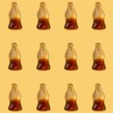 可乐在黄色背景的果冻样式 图库摄影