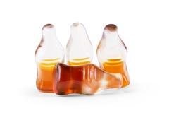 可乐以可乐瓶,孤立的形式风味胶粘的果冻 库存照片