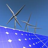 可再造能源-太阳电池板和风车 免版税库存照片