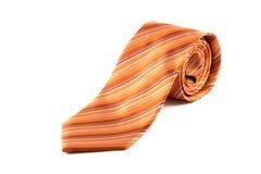 可卷起的橙色领带 免版税库存照片
