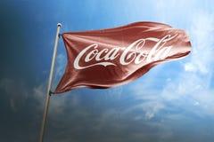 可口可乐照片拟真的旗子社论 免版税库存照片