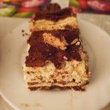 可口焦糖巧克力蛋糕 免版税库存图片