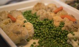 可口豌豆和花椰菜 免版税库存图片