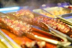 可口BBQ肋骨和气味强烈的BBQ调味 库存照片