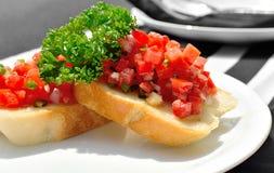 可口bruschetta用蕃茄 库存图片