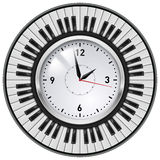 可实现的办公室时钟和钢琴关键字 库存照片