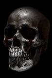 可怕人的头骨,哭泣的血液 免版税库存图片