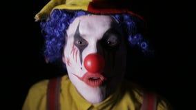可怕小丑尖叫入照相机面孔 特写镜头 股票录像