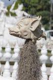可怕石头-巨型头岩石雕塑雕刻了入砂岩峭壁 图库摄影