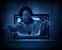 可怕鬼魂从老电视 免版税库存图片