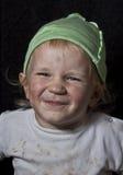 可怜的笑的孩子 库存图片