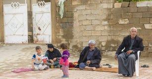 可怜的阿拉伯家庭 图库摄影