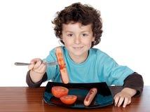 可爱儿童吃 免版税库存照片