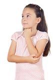 可爱女孩认为 免版税库存图片