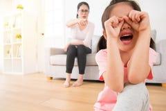 可爱的亚裔女孩很哀伤对哭泣 免版税库存图片