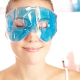 可爱的享用的眼罩妇女 图库摄影