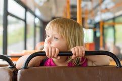 可爱的公共汽车女孩乘驾 库存图片