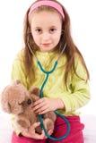 可爱的医生女孩使用的一点 库存图片