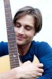 可爱的吉他演奏员 库存图片