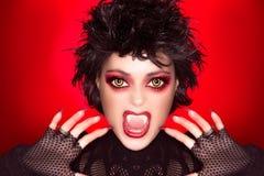 可爱的哥特式女孩。吸血鬼构成。讽刺画 库存图片