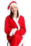 可爱的圣诞老人下来坐椅子 库存照片