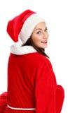 可爱的圣诞老人下来坐椅子 库存图片