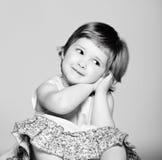 可爱的女孩一点 库存照片