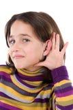可爱的女孩听证会 免版税库存照片