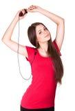 可爱的女孩听音乐微笑青少年 免版税图库摄影