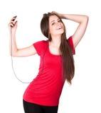 可爱的女孩听音乐微笑青少年 库存图片