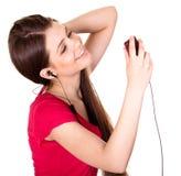 可爱的女孩听音乐微笑青少年 库存照片