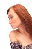 可爱的女孩头发的红色sideview 免版税库存图片