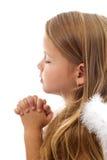 可爱的女孩祈祷的一点 免版税库存照片