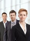 可爱的女实业家和同事 免版税库存照片