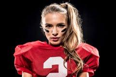 可爱的女性美国橄榄球运动员 库存图片